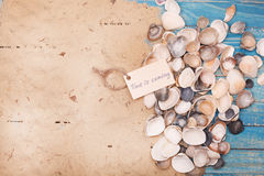 Shells and sand with sign - Time is coming. Vocation and travel background Stock Photos