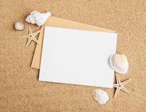 Shells, seastars and an blank postcard Royalty Free Stock Image