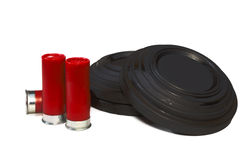 Shells and Skeet. A picture of three shotgun shells and three clay pigeons Stock Photography