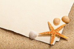 Shells, starfish and blank paper sheet royalty free stock photo