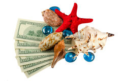Shells starfish and water drops on money isolated. Shells starfish and water drops on dollars isolated Stock Photography