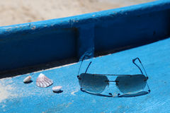 Shells and sun glasses on a boat deck, Boracay Island, Philippines Royalty Free Stock Photos