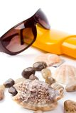 Shells, sunglasses and lotion Royalty Free Stock Photos