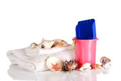Shells, towels and bucket Royalty Free Stock Photos
