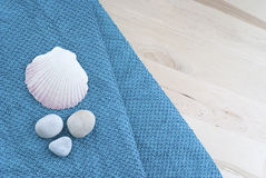 Shells and towels Stock Photos