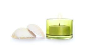Shells und Kerze Stockfotos
