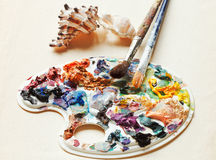 Shells , used artistic pallette, paintbrushes Royalty Free Stock Photo