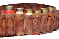Shells van het jachtgeweer in een riem Stock Fotografie