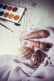 Shells and watercolor paints Stock Images