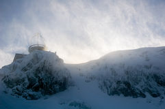 Shelter in blizzard. Shelter on the mountain peak during blizzard with sun behind. Kasprowy Wierch, Tatry, Zakopane Stock Photos