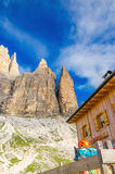Shelter and climbing gear under Tre Cime Royalty Free Stock Image