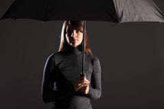 Shelter From Trouble Times Woman Under Umbrella Royalty Free Stock Photography
