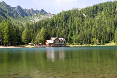 Shelter in high mountain with lake Stock Photography