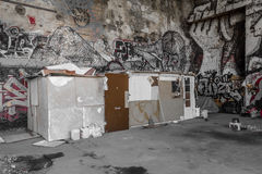 Shelter of homeless people in abandoned factory building stock photo