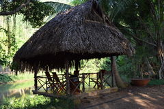 Shelter made by wood and dry leaves near the pond for ecotourism. In Vietnam Royalty Free Stock Images