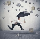 Shelter from the storm of crisis Royalty Free Stock Photo