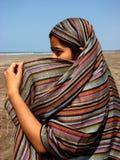 Shelter from the Sun. An Indian teen in an Arabic dress Stock Photo
