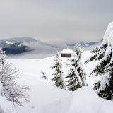 Shelter for tourists in the snowy mountains. Stock Image