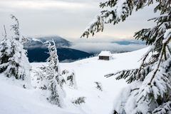 Shelter for tourists in the snowy mountains. Royalty Free Stock Image