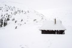 Shelter for tourists in the snowy mountains. Stock Photo