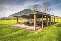 Sheltered picnic tables in Blue Lake park Oregon. Covered picnic area and tables in Blue Lake park Oregon Royalty Free Stock Photography