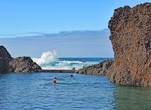 The sheltered pool. Swimmers in a sheltered pool at Madeira`s noth Atlantis coast Royalty Free Stock Images