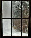 Sheltered from the Storm. View of winter storm through paned window Royalty Free Stock Image