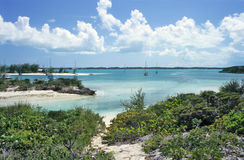 Sheltered Tropical Harbour. Sail boats float moored in a tropical harbour off Stocking Island in the Bahamas stock image