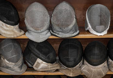 Shelved Fencing Masks Royalty Free Stock Photo