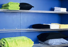 Shelves. Cupboard shelves with some towels Royalty Free Stock Photo