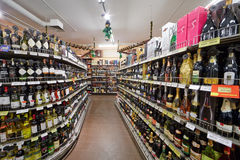 Shelves with alcohol beverages in supermarket Stock Images