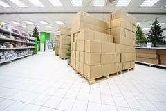 Shelves with artificial Christmas tree, souvenirs Stock Photo