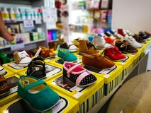 Shelves with Assortment of baby shoes in the store for sale. Royalty Free Stock Photo