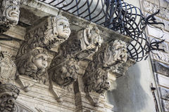 Shelves with baroque masks Royalty Free Stock Photography