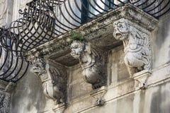 Shelves with baroque masks Stock Photos