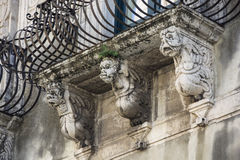 Shelves with baroque masks. Acireale Sicily Stock Photos