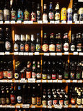 Shelves of Beer in a Specialty Supermarket. A colorful selection of beer bottles lined up on display in the beer department of a specialty supermarket stock photography