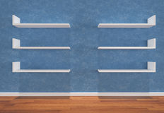 Shelves on blue wall Royalty Free Stock Image