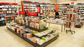 Shelves with books, bookshelf. Shelves in library with many books for sale. Location: large shop in Rome, Italy Stock Image