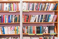 Shelves with books in the library. Blurred background of bookshelves. Education and science. Book store, education and stock image