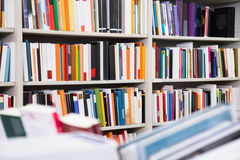 Shelves with books in the library Stock Images