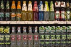 Shelves with bottles low alcohol drinks selling of  Smirnoff, Spy, Eva in supermarket Siam Paragon, Bangkok, Thailand Stock Photos