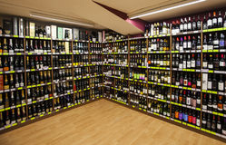 Shelves with bottles. Shelving, shop Stock Photos