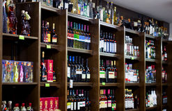 Shelves with bottles of wine in the souvenir shop. CYPRUS, PROTARAS - 13 OCTOBER 2016: Shelves with bottles of wine in the souvenir shop Royalty Free Stock Images