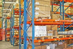 Shelves and boxes. Big warehouse storage room with boxes and shelves Stock Image