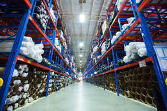 Shelves with boxes in modern warehouse Stock Photography