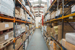 Shelves with boxes in warehouse Stock Image