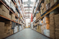 Shelves with boxes in warehouse. Rows of shelves with boxes in warehouse Royalty Free Stock Photography