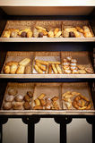 Shelves with bread at store Stock Images