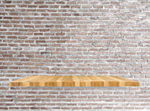 Shelves and brick wall Stock Images